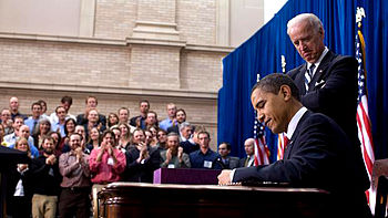 Barack Obama signs American Recovery and Reinvestment Act of 2009 on February 17.jpg